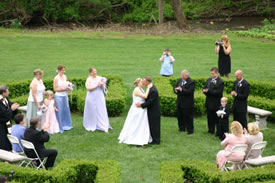 Wedding ceremony in boxwood garden